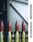 Small photo of Explosive bullet ammo in ammunition belt.