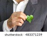 businessman holding a green... | Shutterstock . vector #483371239