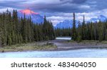 Athabasca River at sunset with Rocky Mountains in background - Jasper National Park, Alberta, Canada