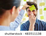 sticky note on man's forehead... | Shutterstock . vector #483511138