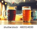 Goblets Light And Dark Beer On...