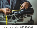 Shoemaker Measuring A Shoe Wit...