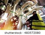modern factory worker turning... | Shutterstock . vector #483572080