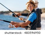 senior man fishing with his... | Shutterstock . vector #483596950