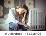 young tired woman sitting on... | Shutterstock . vector #483616408