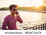 portrait of a smiling guy using ... | Shutterstock . vector #483671674