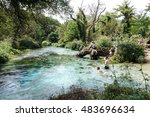 Small photo of MUZINE, ALBANIA-AUGUST 24: Visitors tour Blue Eye spring near Muzine Albania on August 24, 2016. Swimmers and divers visit this popular tourist attraction and fifty meter deep pool.