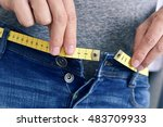 a young man with a measuring...   Shutterstock . vector #483709933