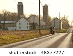 Horse Drawn Amish Cart Being...