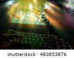 Image concept of Robot Trading System and Stock market trader. Fingers and pen on laptop screen with blur graph trading screen. man hand and robot point finger to each other. Light effect - stock photo