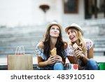 two beautiful girls eating... | Shutterstock . vector #483910510