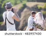 a wedding photographer takes... | Shutterstock . vector #483957430