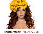 Beautiful Girl With yellow sunflower Flowers. Beauty Model Woman Face. Makeup. Isolated on White Background. Face with a lot of freckles, Red curly hair  fluttering in the wind