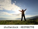 cheering young woman backpacker ... | Shutterstock . vector #483988798
