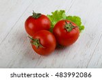 Red Bright Tomato On The Wood...