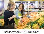 saleswoman showing fresh... | Shutterstock . vector #484015324