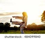 woman training taekwondo sunset.... | Shutterstock . vector #484099840
