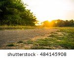 Small photo of Low angle view of booked filter cyclist riding mountain bike and runner. Outdoor cross-country runway in summer sunshine concept for exercising, fitness and healthy lifestyle.