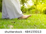 woman walking on green grass... | Shutterstock . vector #484155013