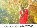 crouching girl in autumnal... | Shutterstock . vector #484207540