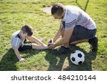 a man with child playing... | Shutterstock . vector #484210144