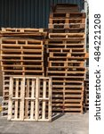 Small photo of Stacks of old wooden shipping cargo pallet for recycling