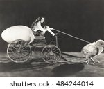 baby chick pulling cart with... | Shutterstock . vector #484244014