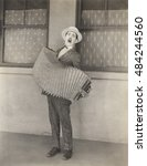 Accordion Player Singing His...