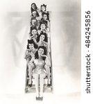 ten chorus girls sitting on a... | Shutterstock . vector #484245856