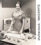 woman rolling dough on kitchen... | Shutterstock . vector #484245970