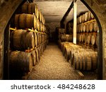 wine barrels stacked in the old ...   Shutterstock . vector #484248628