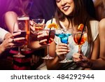 young friendly people toasting... | Shutterstock . vector #484292944