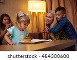 family celebrating children's... | Shutterstock . vector #484300600