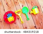 beach toys on  wood background. | Shutterstock . vector #484319218