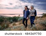 young caucasian couple hiking... | Shutterstock . vector #484369750