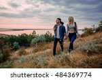 young caucasian couple hiking... | Shutterstock . vector #484369774
