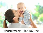 mother and baby on light... | Shutterstock . vector #484407220