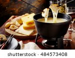 gourmet swiss fondue dinner on... | Shutterstock . vector #484573408
