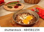 minced meat with fried eggs | Shutterstock . vector #484581154