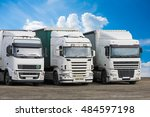 trucks on parking on cloudy sky | Shutterstock . vector #484597198