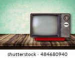 old television on wood table.... | Shutterstock . vector #484680940