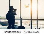 photographer shooting a plane | Shutterstock . vector #484686628