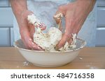 Chef's Hands Kneading The Doug...
