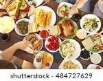 friends eating on picnic | Shutterstock . vector #484727629