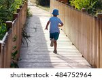 Child Running On A Wooden...