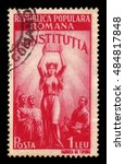 Small photo of ROMANIA - CIRCA 1948: A stamp printed in Romania shows allegorical image of the new Constitution, series new constitution, red, circa 1948