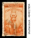 Small photo of ROMANIA - CIRCA 1948: A stamp printed in Romania shows allegorical image of the new Constitution, series new constitution, yellow orange, circa 1948