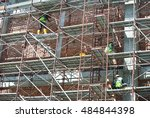 Small photo of SEREMBAN, MALAYSIA -AUGUST 05, 2016: Construction workers wearing safety harness and adequate safety gear while working at high level at the construction site in Seremban, Malaysia.