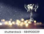 low key image of trophy over... | Shutterstock . vector #484900039