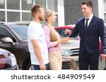 young couple buying car at... | Shutterstock . vector #484909549